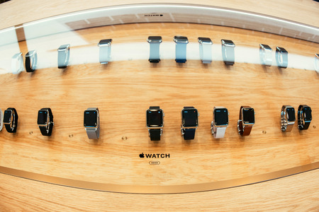 incorporates: PARIS, FRANCE – APR 10, 2015: New wearable computer Apple Watch smartwatch displaying the entire collection. Apple Watch incorporates fitness tracking and health-oriented capabilities and  integration with iOS Apple products and services Editorial