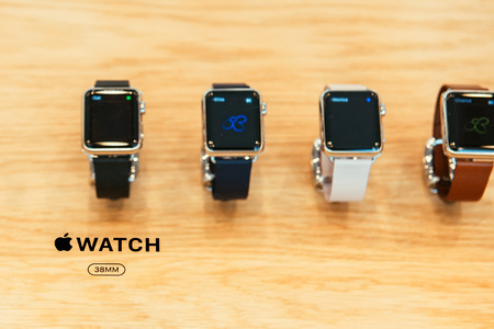 capabilities: PARIS, FRANCE – APR 10, 2015: New wearable computer Apple Watch smartwatch displaying the Watch collection. Apple Watch incorporates fitness tracking and health-oriented capabilities and  integration with iOS Apple products and services Editorial
