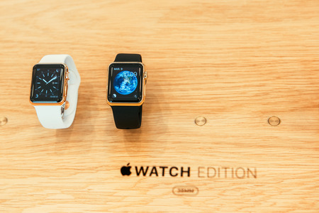 incorporates: PARIS, FRANCE – APR 10, 2015: New wearable computer Apple Watch smartwatch displaying the Edition gold collection. Apple Watch incorporates fitness tracking and health-oriented capabilities and  integration with iOS Apple products and services Editorial