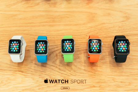 watches: PARIS, FRANCE – APR 10, 2015: New wearable computer Apple Watch smartwatch displaying the Sport edition collection. Apple Watch incorporates fitness tracking and health-oriented capabilities and  integration with iOS Apple products and services