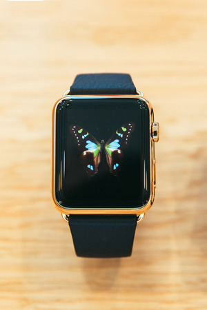 capabilities: PARIS, FRANCE – APR 10, 2015: New wearable computer Apple Watch smartwatch displaying the Edition gold collection. Apple Watch incorporates fitness tracking and health-oriented capabilities and  integration with iOS Apple products and services