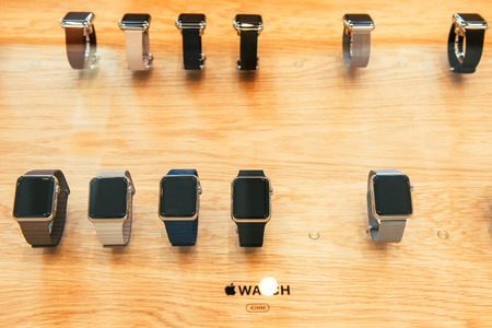 incorporates: PARIS, FRANCE – APR 10, 2015: New wearable computer Apple Watch smartwatch displaying the Watch collection. Apple Watch incorporates fitness tracking and health-oriented capabilities and  integration with iOS Apple products and services Editorial