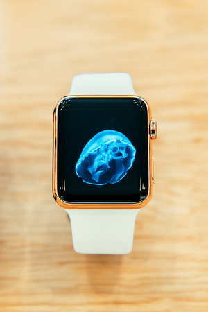 PARIS, FRANCE – APR 10, 2015: New wearable computer Apple Watch smartwatch displaying the Edition gold collection. Apple Watch incorporates fitness tracking and health-oriented capabilities and  integration with iOS Apple products and services Editorial
