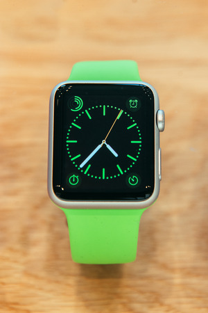 PARIS, FRANCE – APR 10, 2015: New wearable computer Apple Watch smartwatch displaying the Watch collection. Apple Watch incorporates fitness tracking and health-oriented capabilities and  integration with iOS Apple products and services