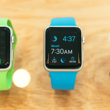 PARIS, FRANCE – APR 10, 2015: New wearable computer Apple Watch smartwatch displaying the Watch collection. Apple Watch incorporates fitness tracking and health-oriented capabilities and  integration with iOS Apple products and services Editorial