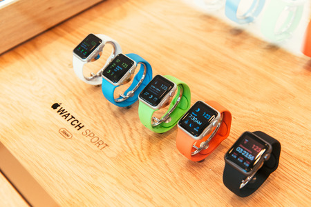 PARIS, FRANCE – APR 10, 2015: New wearable computer Apple Watch smartwatch displaying the Apple Sport Watch collection. Apple Watch incorporates fitness tracking and health-oriented capabilities and  integration with iOS Apple products and services