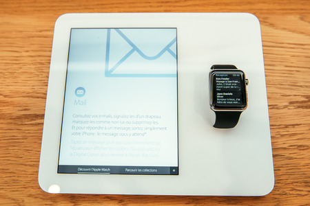 capabilities: PARIS, FRANCE – APR 10, 2015: New wearable computer Apple Watch smartwatch displaying the new Mail Email. Apple Watch incorporates fitness tracking and health-oriented capabilities and  integration with iOS Apple products and services Editorial