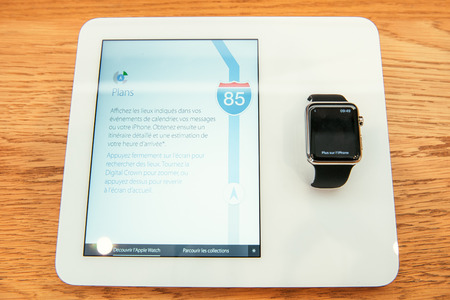 incorporates: PARIS, FRANCE – APR 10, 2015: New wearable computer Apple Watch smartwatch displaying the new Maps App. Apple Watch incorporates fitness tracking and health-oriented capabilities and  integration with iOS Apple products and services
