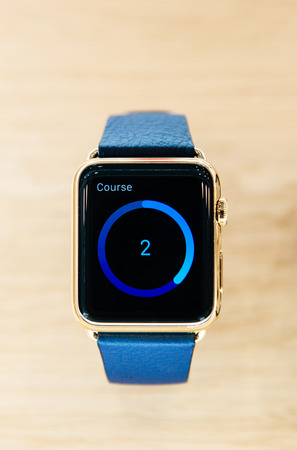 display retina: PARIS, FRANCE – APR 10, 2015: Apple Watch Gold Edition with sport data on its retina display. The most wanted wearable device will be on sale from April 24 in 9 countries and regions