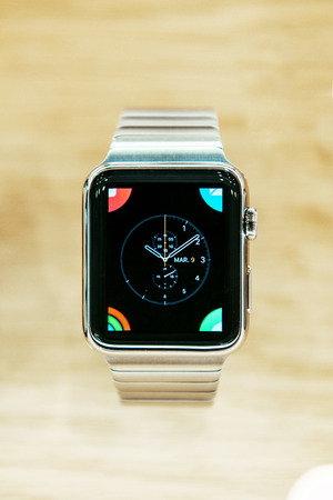 incorporates: PARIS, FRANCE - APR 10, 2015: Stainless verion of Apple Watch smartwatche customization clock face menu. Apple Watch incorporates fitness tracking and health-oriented capabilities and  integration with iOS Apple products and services Editorial