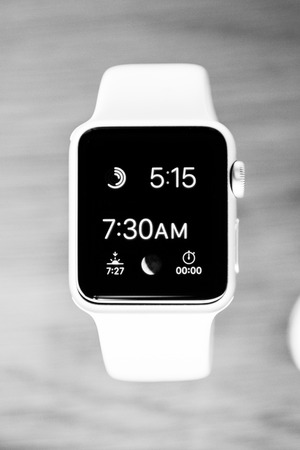 PARIS, FRANCE – APR 10, 2015: Black and white Apple Watch Sport Edition smartwatches displayed at an Apple Store. The most wanted wearable device will be on sale from April 24 in 9 countries and regions