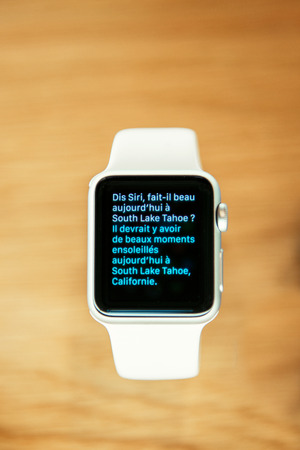 personal digital assistant: PARIS, FRANCE – APR 10, 2015: Apple Watch smartwatche Siri conversation are displayed at an Apple Store. The most wanted wearable device will be on sale from April 24 in 9 countries and regions
