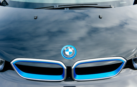 i3: MUNCHEN, GERMANY - APRIL 06, 2015: Electric BMW i3 front radiator grille detail. Previously Mega City Vehicle (MCV), is a five-door urban electric car developed by the German manufacturer BMW.