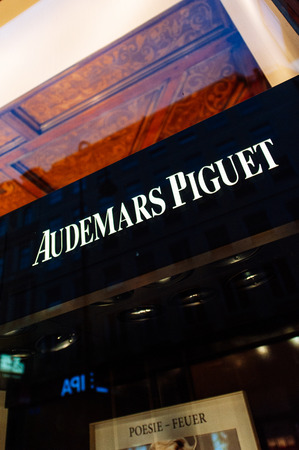 timepieces: VIENNA, AUSTRIA - JULY 4, 2011: Close-up of the Audemars Piguet (AP) logo on the frontage of the Audemars Piguet Luxury store at the Graben shopping street in Vienna, Austria. Audemars Piguet (AP) is a manufacturer of luxury Swiss watches founded in 1875