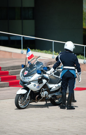 Delegation: STRASBOURG, FRANCE - APRIL 21, 2015: Official delegation police man inext to the red carpet in front of European Court of Human Rights Editorial