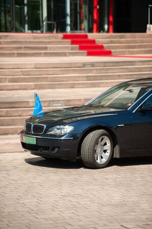 presidency: STRASBOURG, FRANCE - APRIL 21, 2015: Luxury limousine with EU Flag next to the red carpet in front of European Court of Human Rights