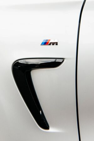 ag: MUNCHEN, GERMANY - APRIL 06, 2015: BMW M sign on rear side of a sports car. BMW M GmbH (previously: BMW Motorsport GmbH) is a subsidiary of German car manufacturer BMW AG. Editorial