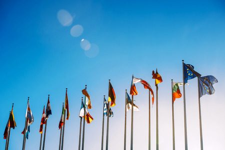 european parliament: Flags in front of the European Parliament against beautiful blue sky in Strasbourg, Alsace, France Stock Photo