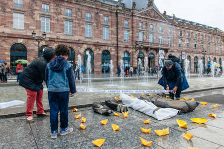 corpses: STRASBOURG, FRANCE - APR 26 2015 Arranging Frontex line over dead corps protest against immigration policy and border management which asks for commitment in the wake of migrants boat disasters