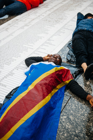french ethnicity: STRASBOURG, FRANCE - APR 26 2015: Die-in protest against immigration policy and border management which asks for commitment in the wake of migrants boat disasters