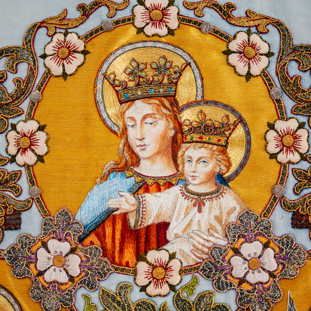 embroidered: Old embroidered religious icon with Virgin Mary holding Jesus Stock Photo