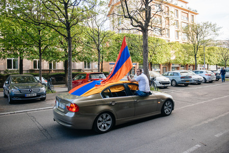 genocide: STRASBOURG, FRANCE - APRIL 24, 2015: Man with Armenian flag in a car during march for 100th remembrance year of Armenian genocide in 1915 as part of Armenian Genocide Remembrance Day