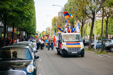public demonstration: STRASBOURG, FRANCE - APRIL 24, 2015: Armenian protesters on truck and streets during the march for 100th remembrance year of Armenian genocide in 1915 as part of Armenian Genocide Remembrance Day