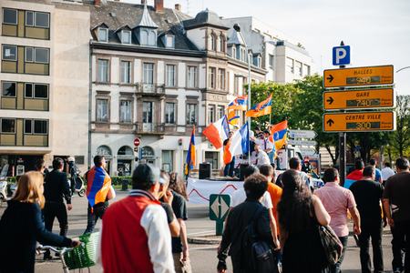 genocide: STRASBOURG, FRANCE - APRIL 24, 2015: Armenian protesters waving flags at march for 100th remembrance year of Armenian genocide in 1915 as part of Armenian Genocide Remembrance Day Editorial
