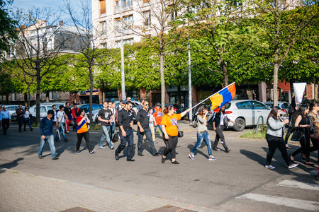 social history: STRASBOURG, FRANCE - APRIL 24, 2015: Armenian protesters with National flags at the march for 100th remembrance year of Armenian genocide in 1915 as part of Armenian Genocide Remembrance Day