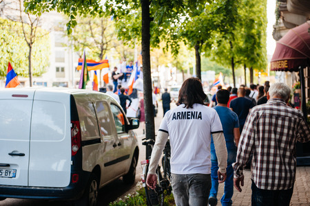 protester: STRASBOURG, FRANCE - APRIL 24, 2015: Armenia on T-Shirt of a protester at the march for 100th remembrance year of Armenian genocide in 1915 as part of Armenian Genocide Remembrance Day Editorial