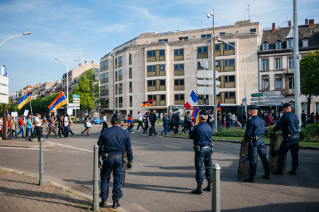 genocide: STRASBOURG, FRANCE - APRIL 24, 2015: Police surveillance over armenian protesters march for 100th remembrance year of Armenian genocide in 1915 as part of Armenian Genocide Remembrance Day Editorial