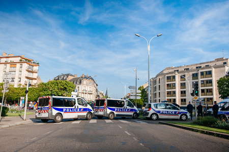 genocide: STRASBOURG, FRANCE - APRIL 24, 2015: Police vans blocking Strasbourg streets while the armenian protesters march for 100th remembrance year of Armenian genocide in 1915 as part of Armenian Genocide Remembrance Day Editorial