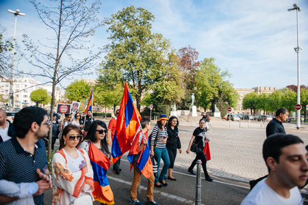 STRASBOURG, FRANCE - APRIL 24, 2015: Armenian protesters march for 100th remembrance year of Armenian genocide in 1915 as part of 'Armenian Genocide Remembrance Day' 에디토리얼