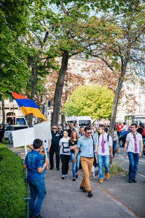 public demonstration: STRASBOURG, FRANCE - APRIL 24, 2015: Armenian protesters march for 100th remembrance year of Armenian genocide in 1915 as part of Armenian Genocide Remembrance Day