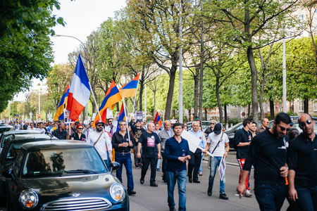 social history: STRASBOURG, FRANCE - APRIL 24, 2015: Armenian protesters march for 100th remembrance year of Armenian genocide in 1915 as part of Armenian Genocide Remembrance Day