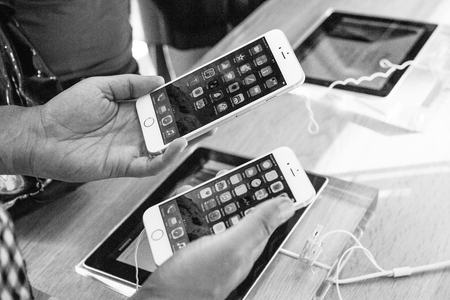 comparing: PARIS, FRANCE - SEPTEMBER 20, 2014: Comparing the new Apple iPhone 6 and iPhone 6 Plus before taking decision to buy one Editorial