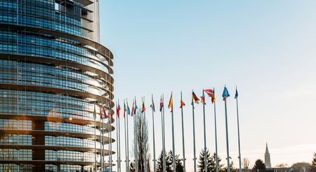european parliament: All European Union Flags in Strasbourg, France at the European parliament on a clear sky day