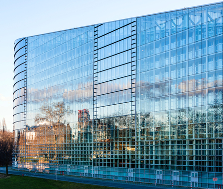 bureaucratic: STRASBOURG, FRANCE - JANUARY 28, 2014: East Facade of the  European Parliament with the plenary room behid in Strasbourg, France
