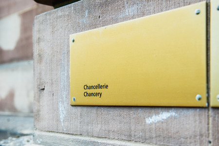 diplomatic: Chancery chancellerie sign on building wall in front of diplomatic corps building Stock Photo