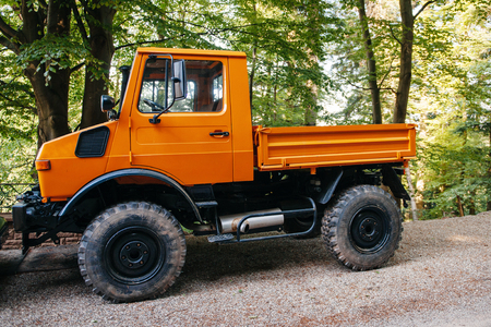 daimler: FRANCE - MAY 10, 2015: Unimog four wheel drive vehicle as seen on a forest road. Unimog is a range of multi-purpose auto four-wheel drive medium trucks produced by Mercedes-Benz, a division of Daimler AG.