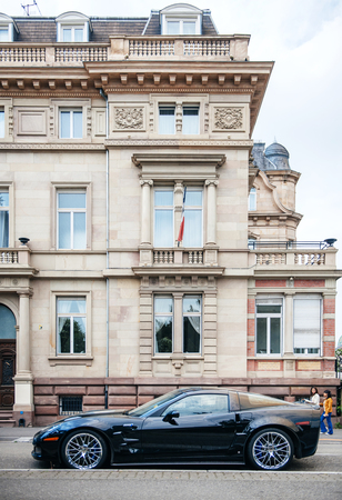 inter: STRASBOURG, FRANCE - MAY 16, 2015: Chevrolet Corvette ZR 1 luxury sport car parked in front of historic building hotel. Between 2008-2014 only 4,684 were produced.