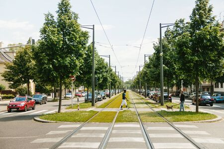 railroad track: STRASBOURG FRANCE  MAY 23 2015: Black ethnicity man crossing roads in the middle of railroad track