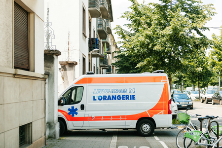 paramedics: STRASBOURG FRANCE  MAY 23 2015: Paramedics ambulance parked as exception on bicycle and pedestrian road Editorial