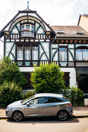 recently: STRASBOURG FRANCE  MAY 23 2015: Old house decorated with beautiful old paintings renovated recently by the owners as seen in Neudorf Strasbourg France Editorial