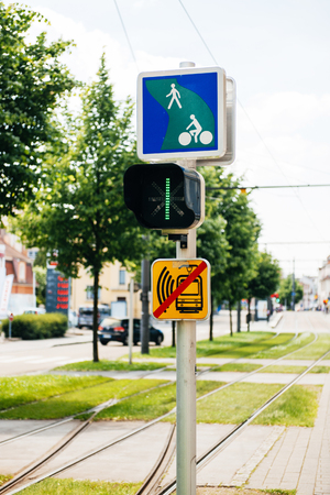 tramway: Tramway semaphore with instruction to bikers in green city urban area