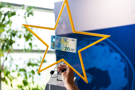 euro area: STRASBOURG FRANCE  MAY 2 2015: Presentation of the new 20 Euro banknotes by the European Central Bank official. The new 20 Euro banknote with the European symbol Europe is highly protected and has a new design and will start circulating in the euro area o