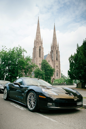 supercharged: Chevrolet Corvette ZR 1 luxury sport car parked with St Paul church towers in backgroundl. Between 20082014 only 4684 were produced. Editorial