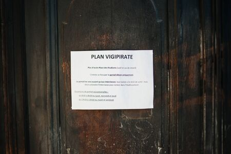 vigilance: STRASBOURG FRANCE  APRIL 18 2015: Security measures instruction on a school door during the country wide Plan Vigipirate after the Charlie Hebdo shooting.