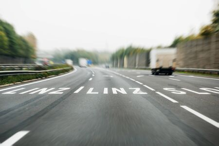 linz: German autobahn with roadmarking sign to Linz, Austria. Focusing on the Linz letters