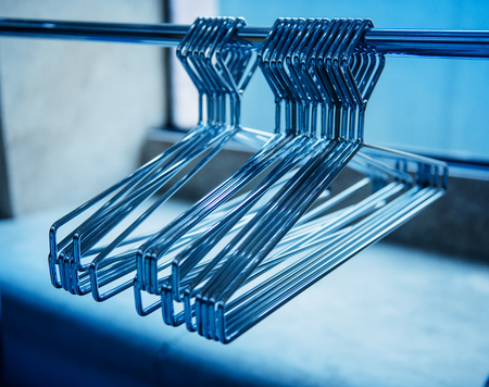 clothes rail: Metallic coat hangers on clothes rail - empty closet